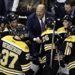 Boston Bruins head coach Claude Julien instructed his team during a timeout in the third period of an NHL hockey game against the New Jersey Devils.